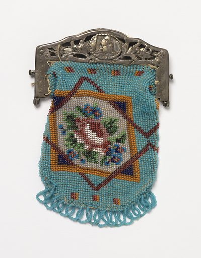 Knitted bag with colored glass beads in a design of a rose with forget-me-nots in an eight-pointed star on a blue ground; finished at bottom with blue bead fringe and at top with a metal frame ornamented with cut-out floral designs and engraving. Made in: USA. Date: 1800s. Record ID: chndm_1945-54-26.