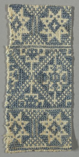Design of lozenges and eight-pointed stars worked in blue cross-stitch on a white ground. Made in: Greece. Date: 1800s. Record ID: chndm_1946-42-8-a.