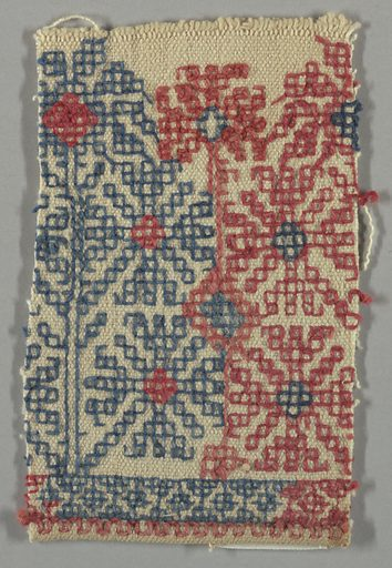 Design of four stylized flowers arranged around a central block, worked in red and blue on a white ground. Made in: Greece. Date: 1800s. Record ID: chndm_1946-42-8-b.