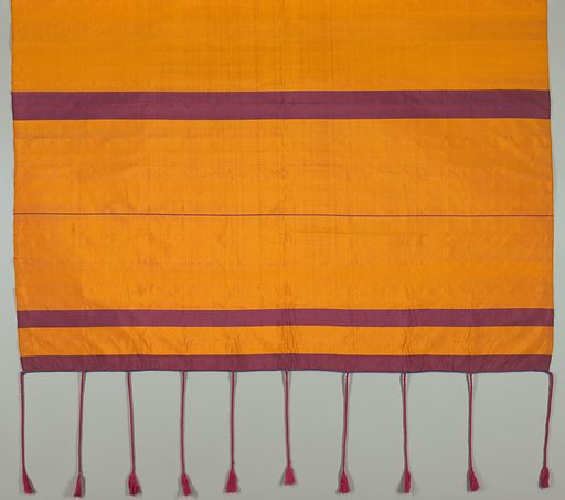 Head cloth made of yellow silk with five broad and two narrow stripes in vine. The textile is in loom width, both ends finished in buttonhole stitch of blue silk and red tassels. Date: 1800s. Record ID: chndm_1946-7-2.