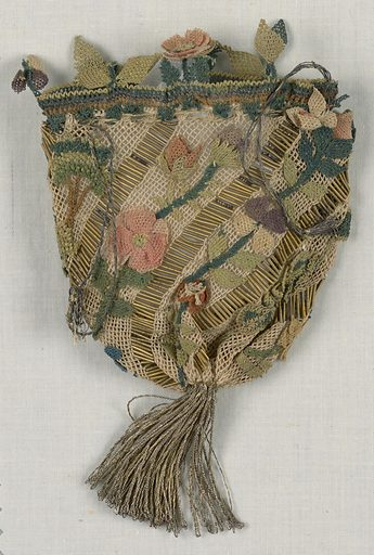Drawstring bag with large metal tassel at bottom. Diagonal bands of white netting separated by bands of metallic purl. Bebilla flowers and fruit applied along netting and in a deep border at the top. Made in: Turkey. Date: 1800s. Record ID: chndm_1951-105-20.