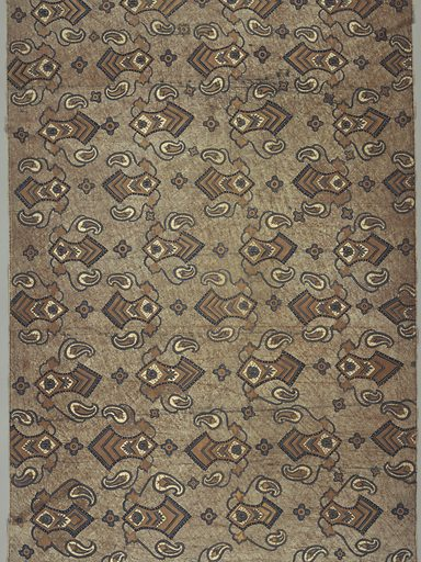 Long cotton sarong (kain panjang) featuring diagonal repeat of medium-sized decorated blade-like motifs with stylized leaves and flowers attached to curving stems alternating with small four-lobed rosettes in dark blue, white, and cocoa brown. Design on a ground of cocoa crackle and five dark wavy parallel comb marks. Two plain selvedges, narrow hem at one end. Reversible. Made in: Indonesia. Date: 1800s. Record ID: chndm_1951-111-20.