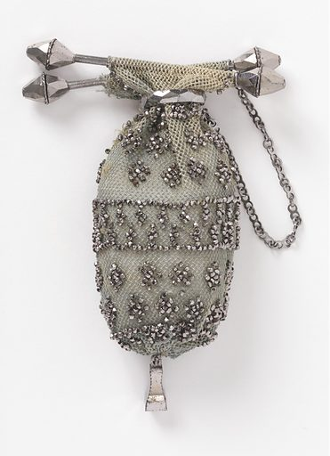Fine grey silk crocheted net with cut steel beads; steel bars, ring, and chain at top. Pendant ornament of cut steel at bottom. Made in: France. Date: 1800s. Record ID: chndm_1953-106-21.