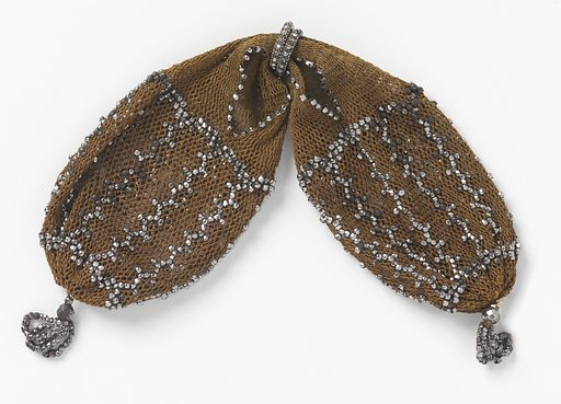 Light brown crocheted silk ornamented with cut steel beads in simple pattern of connected rectangles. Very small cut steel rings control side opening; small bead tassels at either end. Made in: France. Date: 1800s. Record ID: chndm_1953-106-29.
