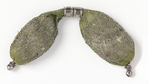 Soft green colored crocheted silk ornamented with cut steel beads in diamond pattern. Two hexagonal rings of cut steel control side closing. Cut steel drops, in faceted ball shape, at each end. Made in: France. Date: 1800s. Record ID: chndm_1953-106-30.