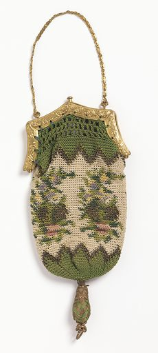 Small purse of crocheted silk and gold thread in green, white, red and faded yellow in pattern of flower clusters. Green saw tooth border at top and bottom. Set into a gold frame at top with catch to close. Fine gold chain for carrying. Made in: France. Date: 1800s. Record ID: chndm_1953-106-4.