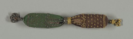 One side in green crocheted silk with cut steel beads; the other in brown silk ornamented with gold beads. The side opening is controlled by two rings, one of cut steel, the other of gold. A cut steel tassel is attached to the green silk end while an ornamental gold drop decorates the brown end. Made in: France. Date: 1800s. Record ID: chndm_1953-106-42.