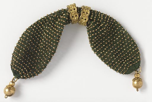 Purse or long sac of crocheted dark green silk, ornamented evenly with gold beads; opening at side controlled by two rings. Small round gold drop at each end. Made in: France. Date: 1800s. Record ID: chndm_1953-106-45.