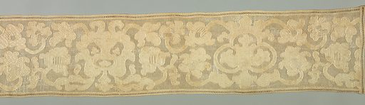 Large symmetrical stylized floral forms with supplementary flower heads on thick curving stems. In various fancy surface stitches in white linen thread on a white linen cloth with heavy embroidered outlines on a square-meshed ground. Made in: Russia. Date: 1800s. Record ID: chndm_1953-60-6.