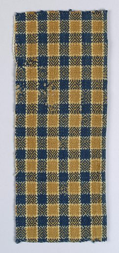 Check of alternating dark blue and warm tan stripes in both the warp and weft, with off-white accents. Diamond or birds-eye twill effect in woven pattern. Made in: USA. Date: 1800s. Record ID: chndm_1954-98-1-a_c.