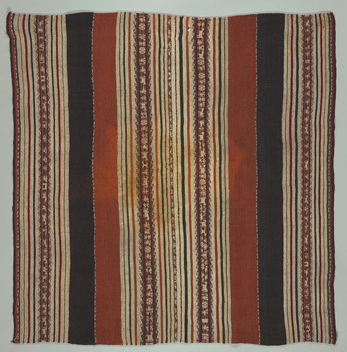 Square made of two lengths seamed down long side. Broad dark brown and rust stripes and brown cream stripes with think stripes of blue and red. Warp-patterned stripes in these colors decorated with animals, flowers, geometrical forms. Double loom cords top and bottom. Elaborate herringbone stitch in brown and blue wool covers center joining. Made in: Bolivia. Date: 1800s. Record ID: chndm_1955-157-9.
