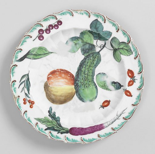 Flat marly springing from scalloped inner rim. Raised, feathered edge, painted brown and green. In center, large and small cucumber and an apple. On marly, three rose hips, a purple long radish, currents and small red berries. Date: 1750s. Record ID: chndm_1955-163-1.