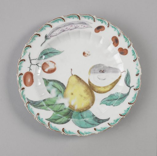 Scalloped circular form with brown and aqua foliate scroll. Foliage includes a pear, plums, kidney beans, and beans in a pod. Date: 1750s. Record ID: chndm_1955-163-9.