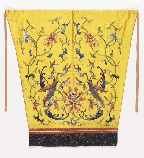 Deep golden yellow satin with symmetrical design of a phoenix in floral arabesque on either side of large floral rosette. In bright silk satin stitch with details in French knots, outlined in couched gold thread. Cuff band of orange and black ribbed cloth brocaded in paper gold. Lined with salmon pink satin, now faded. Made in: China. Date: 1800s. Record ID: chndm_1955-67-3.