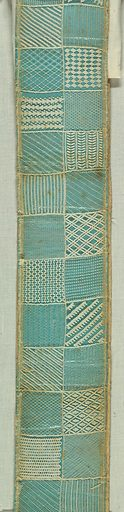 Seventy-eight needlework patterns embroidered on a ground of hexagonal mesh. Mounted on stiff green paper. Made in: Germany. Date: 1800s. Record ID: chndm_1957-180-43.