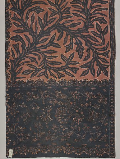 Batik sarong in brown, pink, and dark blue. Dark blue seaweed pattern placed freely over the pink-brown ground in the body or 'badan' of the piece. The head or 'kepala' (broad band with different coloring and pattern than remainder) shows dark ground with floral pattern. Made in: Pekalongan, Indonesia. Date: 1800s. Record ID: chndm_1961-115-29.