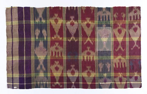 Oblong panel with a large plaid design made by groups of white and green stripes. Warp print pattern in shades of purple, red, blue, green and yellow. Pattern of a tree appears in alternate rows. Date: 1800s. Record ID: chndm_1961-49-3.