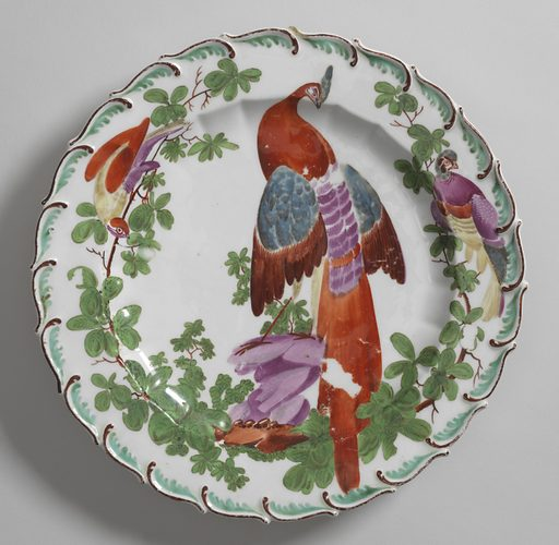 Scalloped edge with green feather motif. Fluted cavetto. At center, a tropical bird. Date: 1750s. Record ID: chndm_1962-218-2.