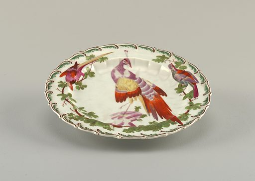 Scalloped edge with green feather motif. Fluted cavetto. At center, a tropical bird. Date: 1750s. Record ID: chndm_1962-218-6.