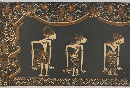 """Oblong cotton panel in black, dark blue, cream-white, and light brown. Shows six """"wayang"""" puppets, moving toward center shrine, bearing Rama, a god-like figure. Outer border shows """"ship of the dead"""" design and """"lar"""" (wing of Garuda, the mount of Vishnu) motif. Made in: Indonesia. Date: 1800s. Record ID: chndm_1962-233-5."""