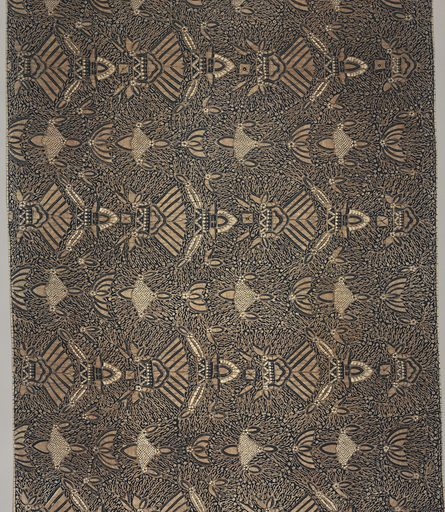 """Long batik sarong (kain panjang) in dark blue, light brown, and white. Dark blue ground showing numerous white dots known as """"gabah sinawur"""" or 'grains of rice'. Also shows an all-over pattern of heraldic motifs """"semen"""" (curling tendrils and other non-geometric forms) and """"sawat"""" (wings and tail of Garuda, mount of Vishnu) as well as mountains . Made in: Indonesia. Date: 1800s. Record ID: chndm_1962-233-9."""