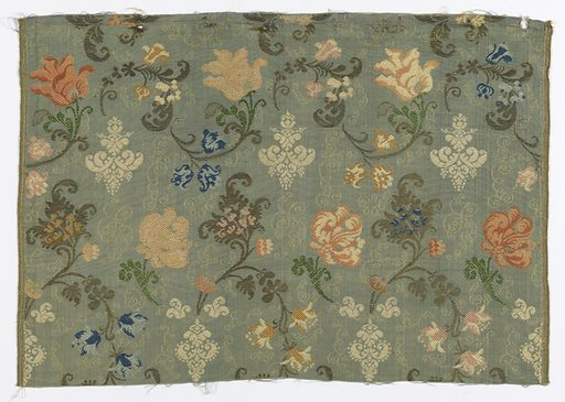 Straight repeat of curving floral forms in multiple colors and metallic thread on a blue-gray background. Made in: Europe. Date: 1800s. Record ID: chndm_1962-58-32.