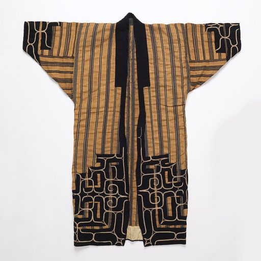 Robe made from narrow widths of cloth woven from elm bark, in tobacco brown with varied stripes of dark indigo blue and white. Dark blue cotton appliqué with white couched-thread embroidery adorns the hemline, sleeve cuffs, and upper back. Dark blue cotton neckband. Made in: Japan. Date: 1800s. Record ID: chndm_1962-67-1.