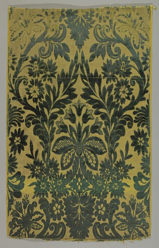 Five pieces of velvet forming a panel. Elaborate floral groups with leaves and vines in dark green velvet on a yellow and gold background. On face, extra weft floats of yellow silk alternating with metal strips. Made in: Russia. Date: 1800s. Record ID: chndm_1967-20-14-a_c.