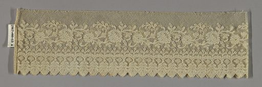 Borders of bobbin lace with Valenciennes ground worked in a meandering floral design above a border of vertical sprigs, scallops and pendant leaves forming the edge. Made in: France. Date: 1800s. Record ID: chndm_1967-46-13-a_c.