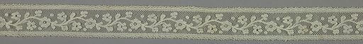 Valenciennes style lace band worked with a floral design and conventional borders. Made in: France. Date: 1800s. Record ID: chndm_1967-46-17.