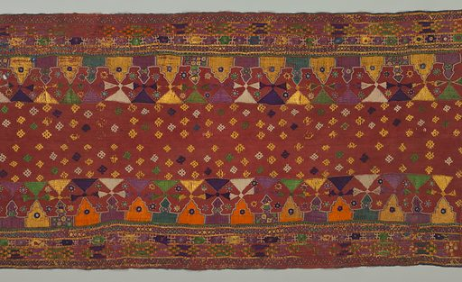 Heavy rust red cotton heavily embroidered in multi-colored silks and mirrors. Many patterned borders run parallel to the central area which is worked in small detached geometric motifs. Panel consists of two pieces stitched together. Made in: India. Date: 1800s. Record ID: chndm_1967-85-12.