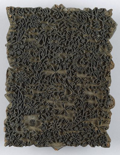 Block for printing textiles with a dense design of curving stems and flowers. Contemporary picture hangers attached. Made in: India. Date: 1800s. Record ID: chndm_1968-135-57.