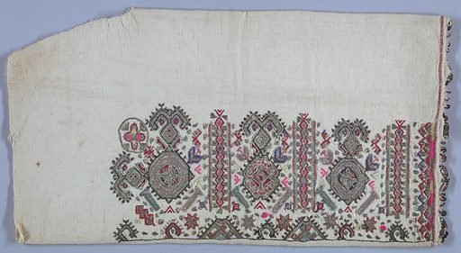 Sleeves of heavy cotton embroidered in repeat pattern of highly stylized medallions, plant and geometric forms. Worked with silver thread, pink, lavender and citron wool, and red, purple and green cotton. Pailettes are attached to the crocheted edges of the sleeves. Made in: Balkans. Date: 1800s. Record ID: chndm_1969-86-15-a_b.