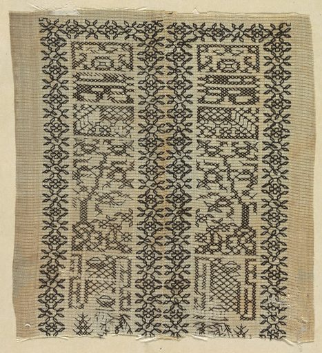 Fragment of gauze with black geometric embroidery surrounded by narrow floral bands. Made in: China. Date: 1800s. Record ID: chndm_1971-50-152.