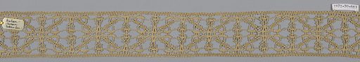 Fragment of provincial lace worked in a pattern of geometric rectangles. Made in: Italy. Date: 1800s. Record ID: chndm_1971-50-463.