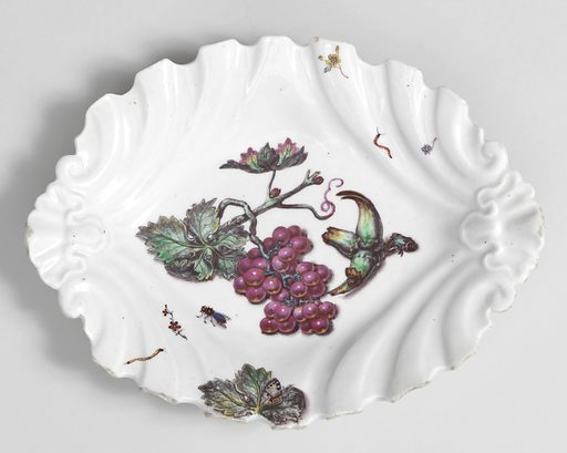 Dish with scalloped edges in ovoid; at center, bunch of grapes on stem with leaves and insects. Date: 1740s. Record ID: chndm_1985-120-4.