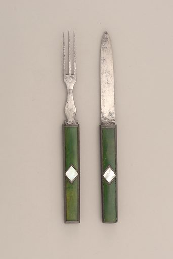 Three flat tines, flat baluster-shaped neck. Rectangular handle with pewter sides. Front and back green painted ivory, inlaid with diamond-shaped mother-of-pearl and pewter in the centre of the handle. Blade of knife slides into handle of fork, tines of fork slide into handle of knife. Made in: probably Germany. Date: 1800s. Record ID: chndm_1985-103-133-b.