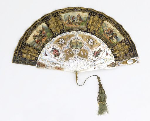 Pleated fan. Gilded paper leaf with lithographs. Obverse: purple and copper-colored paper gilded showing three proscenium arches with curtains and pseudo-Renaissance motifs framing hand-colored lithographs of theatrical Spanish scenes. At left, a drinking party in fancy dress; at center, a large masked ball; at right, a queen and three attendants in a loge. Reverse: Three framed hand-colored lithographs of Spanish scenes in mountainous country. At left, two women at a well listening to minstrels; in center, groups of men at leisure with horses and riders; at right, men with a donkey. Gilded mother-of-pearl sticks, brilliantly painted on obverse and reverse with birds, flowers and scrolls. Reverse sticks decorated with small painted lithograph of Chenonceau. Oval mirror with gold frame set in guards. White paste jewel rivet head; gilt metal bail. Pale green silk tassel with gilt ornaments and beads. Made in: France. Date: 1840s. Record ID: chndm_1952-161-206.