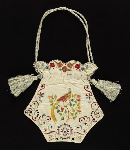 Ladies' bag of white moiré silk embroidered in colored silks. Shape is five-sided, flat, with a scalloped top. Borders of flower wreaths. Embroidered on one side with a greyhound and with a long-tailed bird on the other. Worked as two separate panels, joined. Lined in pale blue taffeta. Blue and white silk cord. Made in: France. Date: 1820s. Record ID: chndm_1951-105-12.