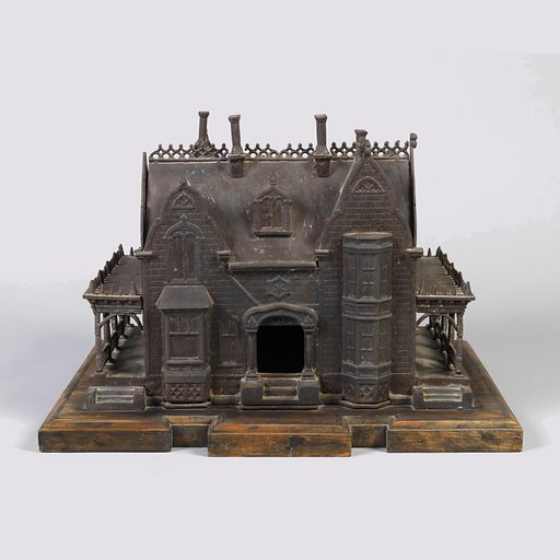 Large metal house, meant to look like brick, with pointed arches and colonnaded side verandas, on a wooden base. Made in: Providence, RI, USA. Date: 1860s. Record ID: chndm_2013-3-8.