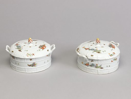 A white porcelain covered dish with a basket textured exterior. The covered dish has basket textured handles and an acorn knob. Date: 1730s. Record ID: chndm_1949-149-3-a_b.
