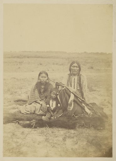 Arapaho Chief Powder Face, his wife, and Their Son. Date: 1868. Culture: American. Object number: 84.XP.785.4.