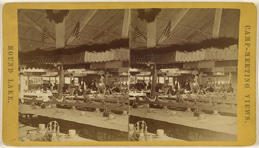 Group of people inside dining hall with numerous tables, Round Lake, Ballston Spa, New York – Camp-Meeting view. Date: about 1870–1875. Culture: American. Object number: 84.XC.979.889.