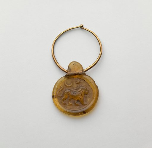 Glass stamped disk pendant with gold hoop (late 4th–5th century AD). Late Imperial. Roman. Accession number: 74.51.4034.