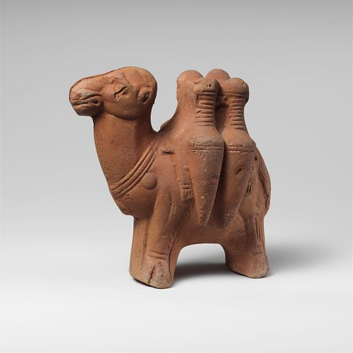 Terracotta figurine of a camel carrying transport amphorae (late 2nd–early 3rd century AD). Mid-Imperial. Roman, Egyptian. Accession number: 89.22093.