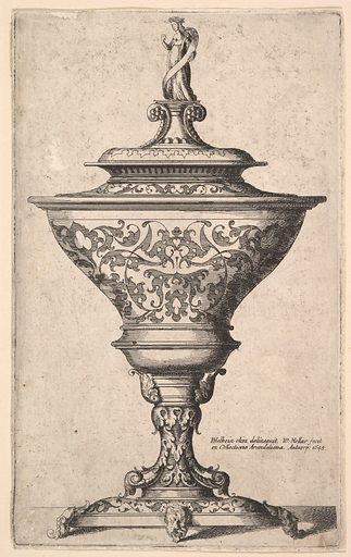 Ornate goblet on feet of masks (1645). Accession number: 17.46.3.