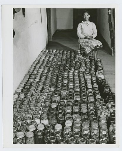 Mrs Gus Wright, Farm Security Administration client with her canned goods, Oakland community, Greene County, Georgia, November 1941. Date: 1941–11. Collection: Farm Security Administration Collection, Georgia, Jack Delano. Image ID: 1260071.