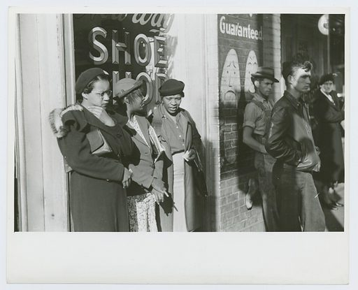Domestic servants waiting for street car on way early in the morning. Mitchell Street, Atlanta, Georgia, May 1939. Date: 1939–05. Collection: Farm Security Administration Collection, Georgia, Marion Post Wolcott. Image ID: 1260094.