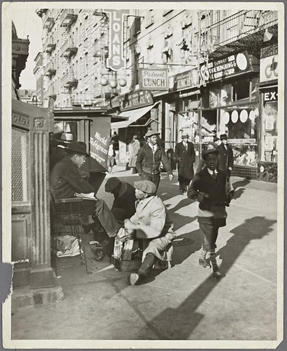 View of Lenox Avenue, Harlem, at 135th Street, showing businesses, pedestrians and shoe-shine stand, March 23, 1939. Date: 1939–03-23. Collection: Street Scenes, Harlem, 1900–1970s, Harlem, 1930s. Image ID: 2014188.
