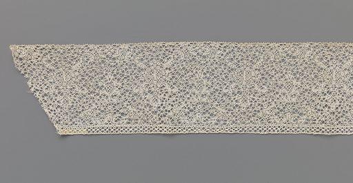 Strip bobbin lace with two candelabra motifs. Origin: Southern Netherlands. Date: c 1690 – c 1699. Object ID: BK-1973-88-B.